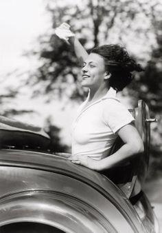 Martin Munkácsi - Eva Szaplone in a Rumbleseat 1932